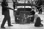 Defacing a portrait of Hitler, August 27, 1944